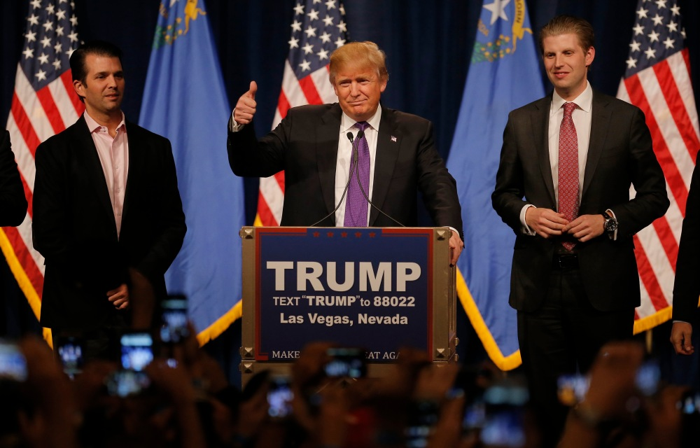 Republican U.S. presidential candidate Donald Trump is flanked by his sons Donald Jr. and Eric as he addresses supporters after being declared by the television networks as the winner in the Nevada Repulican caucuses at